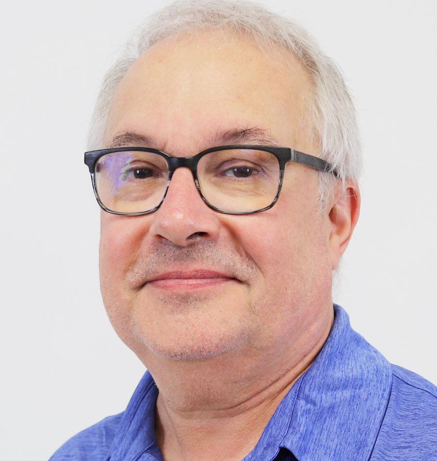 headshot of Dean Hughes